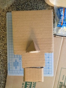 A basic robot head with moving jaw. - DIY Cardboard Robot Puppet