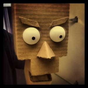 Facial features in place. - DIY Cardboard Robot Puppet